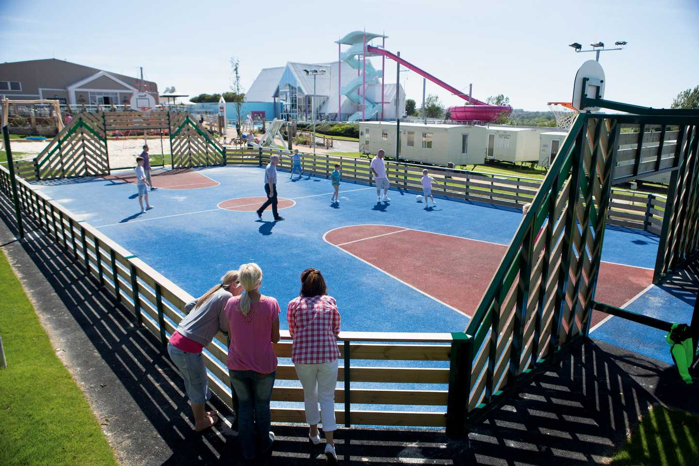 Guests playing ball games on the sports court