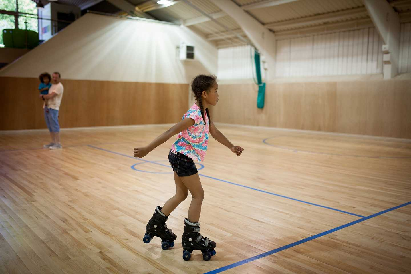 Girl skating in hall