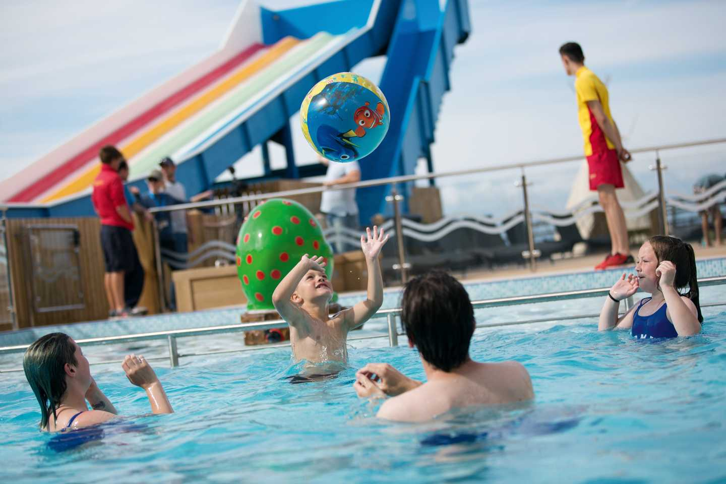 A group of guests in the outdoor pool