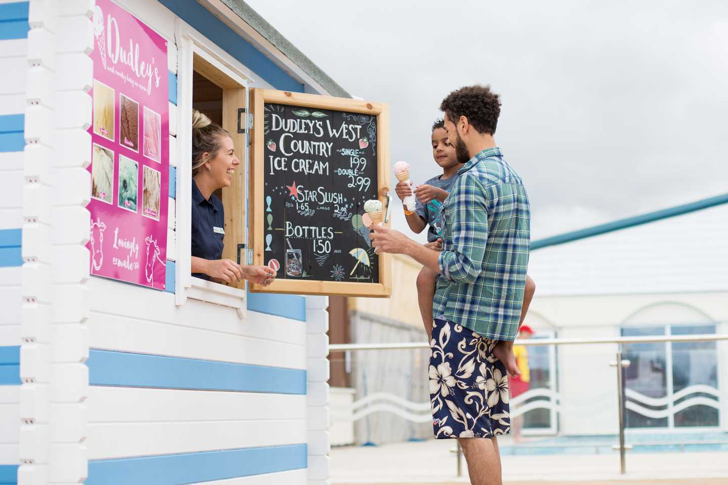 A father and child buying icecream