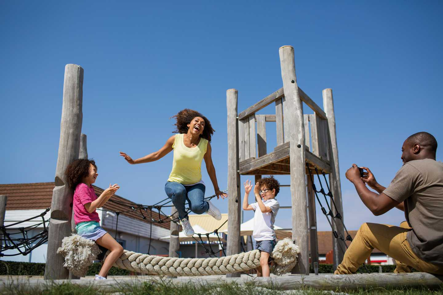A child playing in the outdoor play area