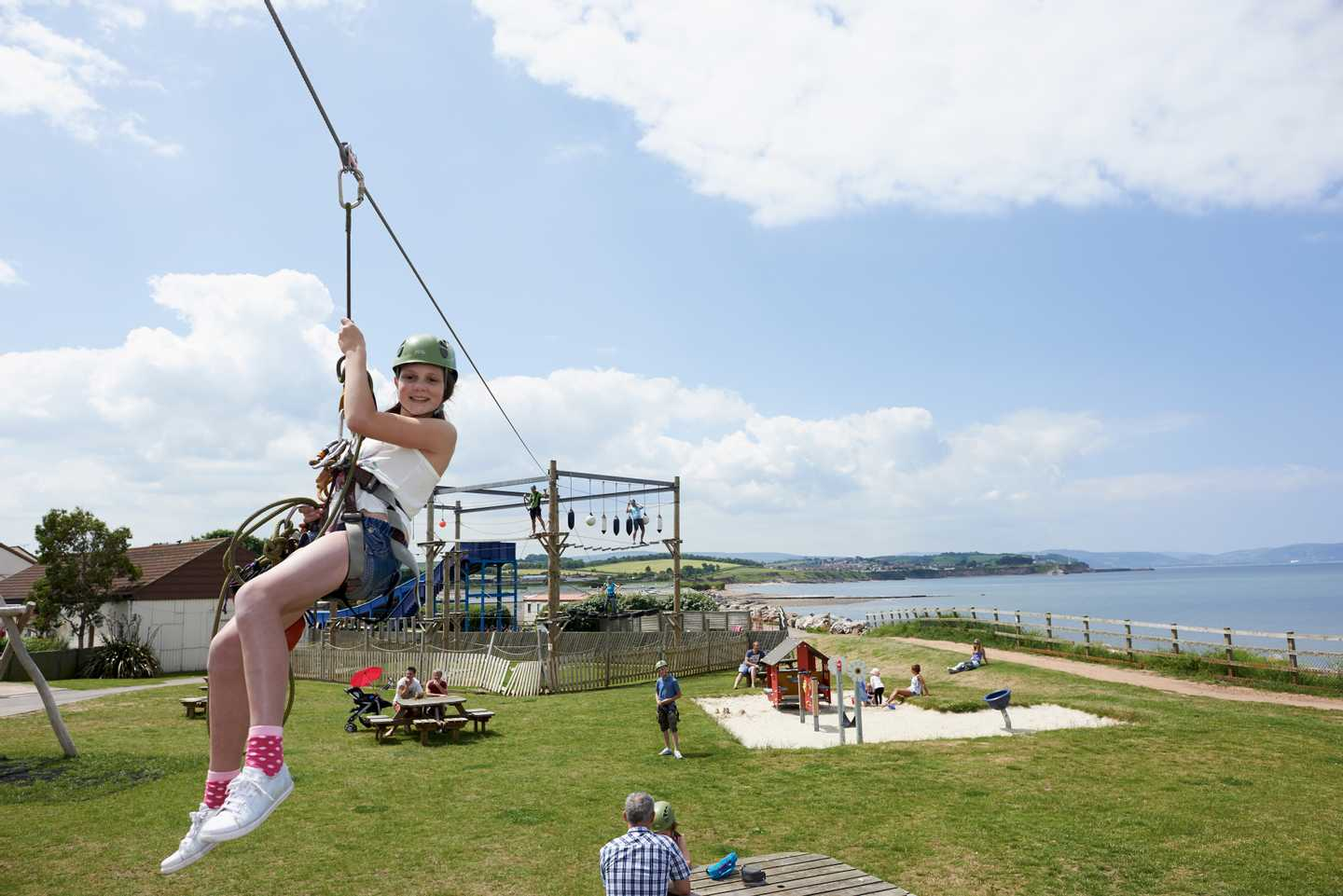 A guest on the zip wire at Doniford Bay
