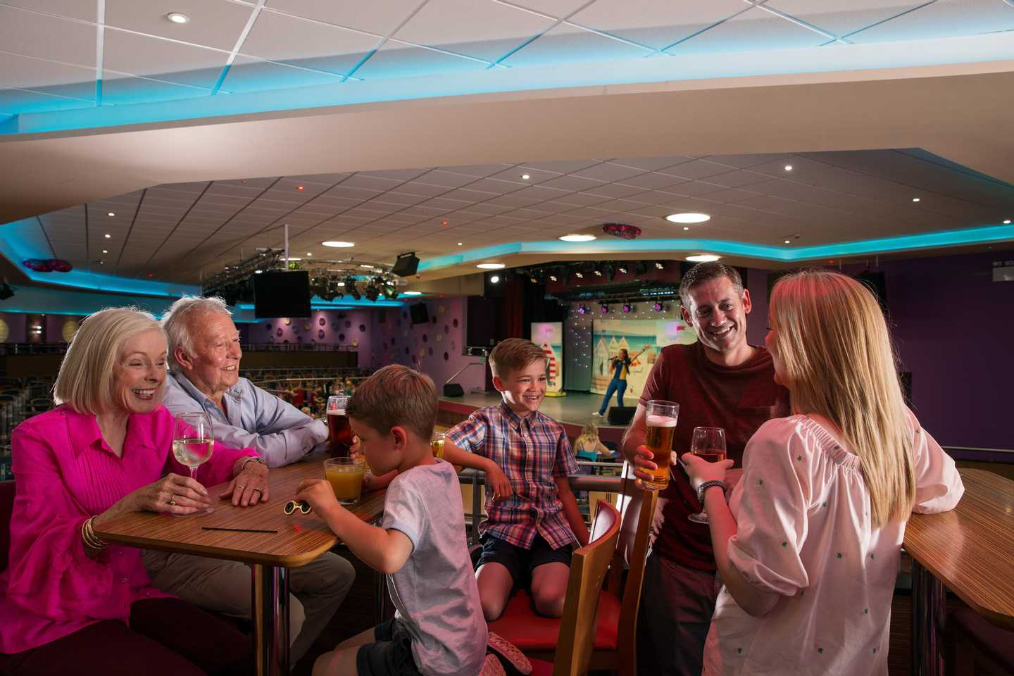 A family in the Live Lounge entertainment venue