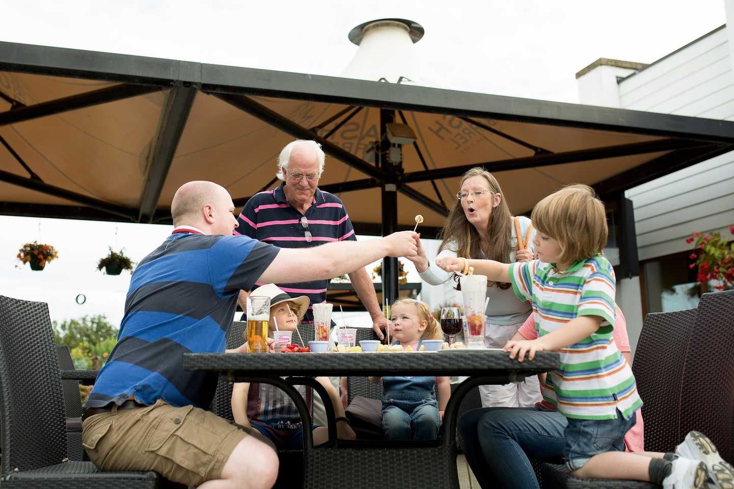 A family enjoying their meal in our Mash and Barrel terrace