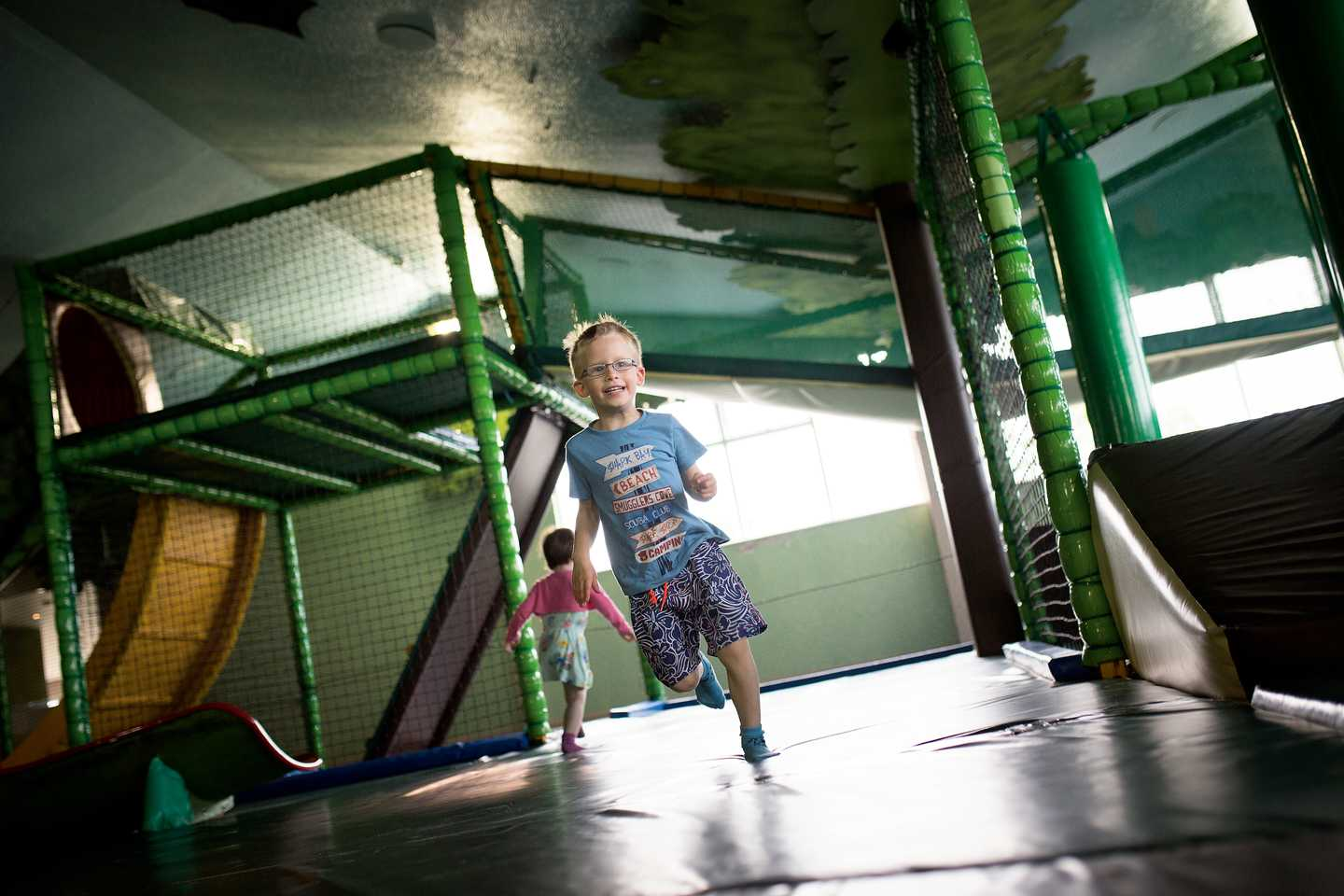 A child running through the indoor play area