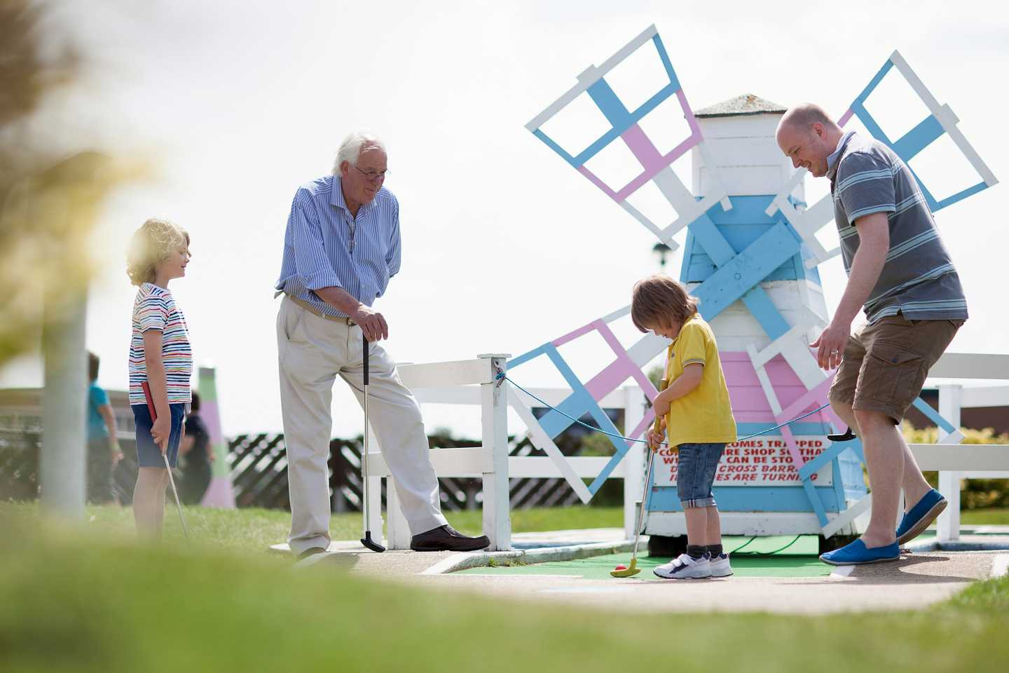 A family playing on the crazy golf course