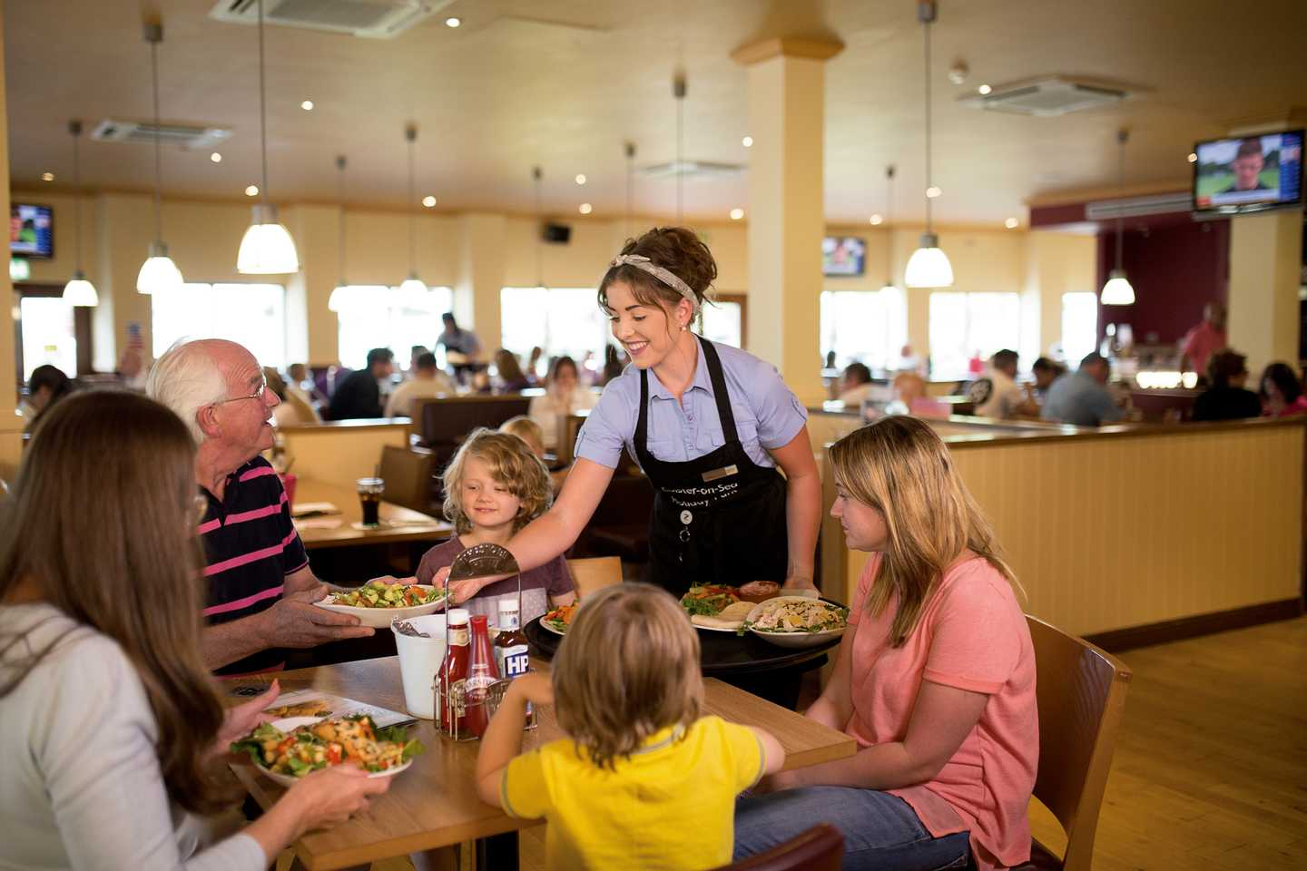 Family enjoying a meal at the Mash and Barrel bar and restaurant
