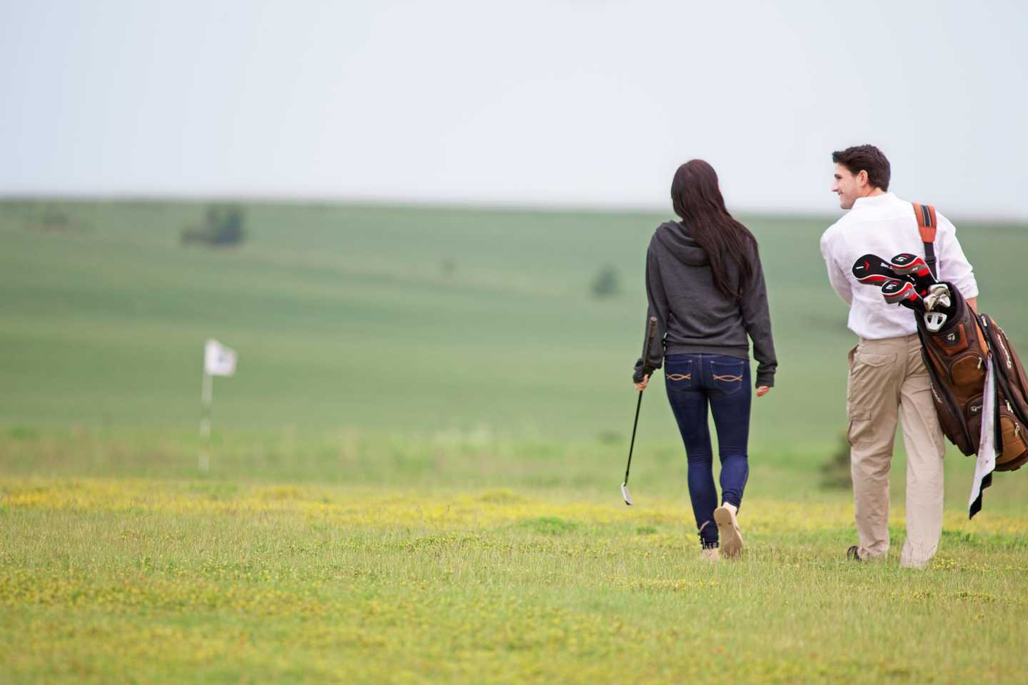 A couple walking along the 9-hole golf course