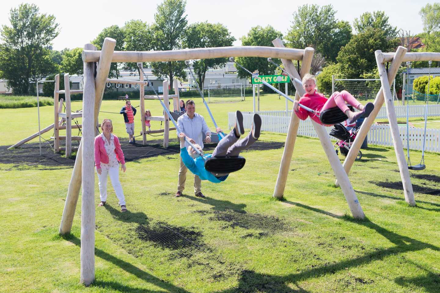 Children swinging in the play area