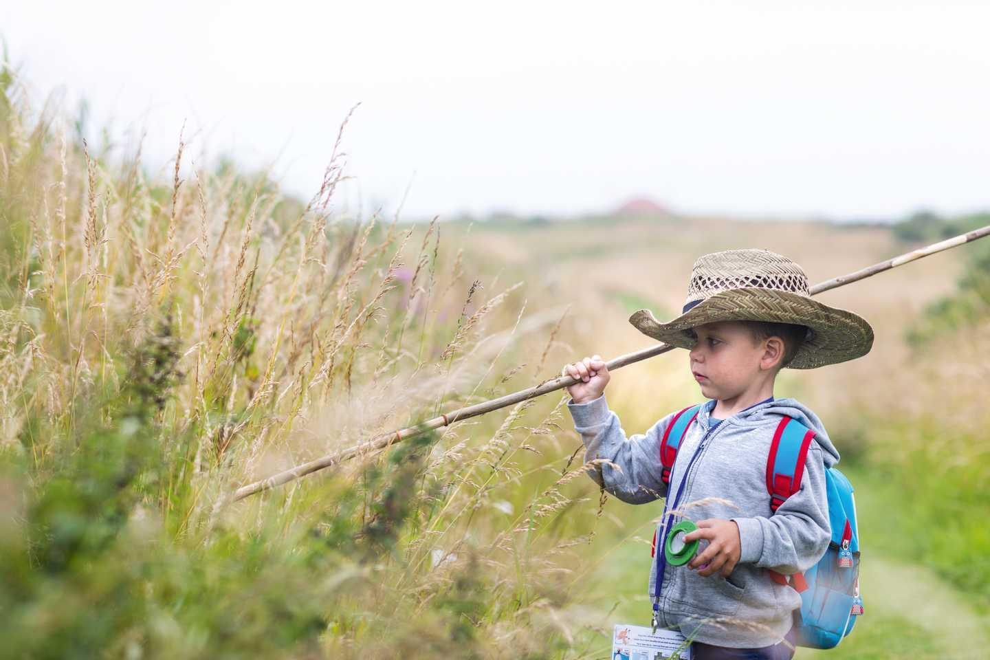 Child exploring the environment in cowboy hat