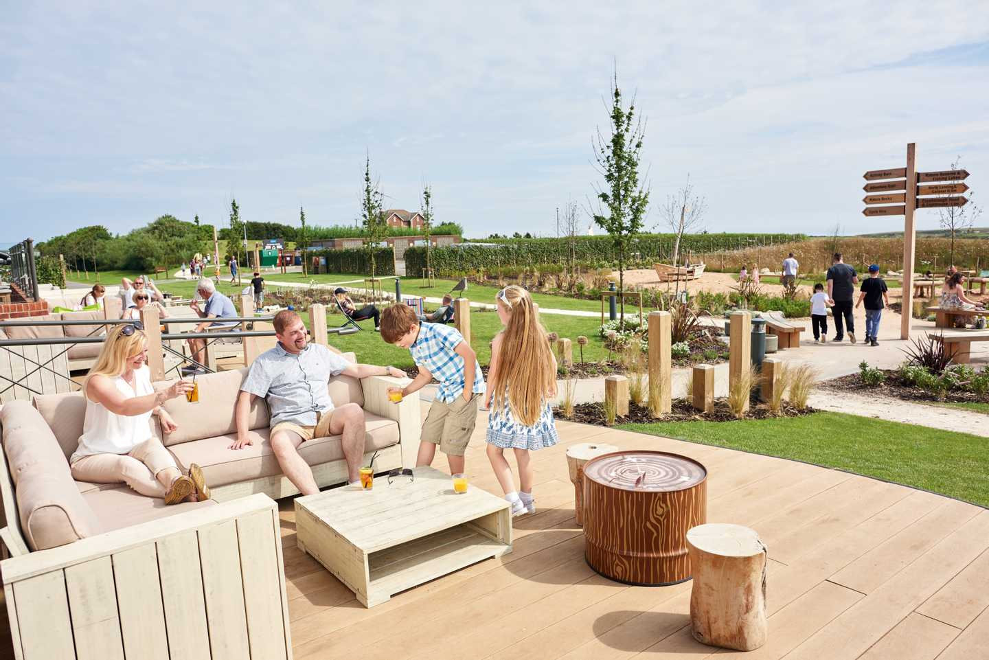 Guests relaxing on The Lighthouse terrace area at Thornwick Bay