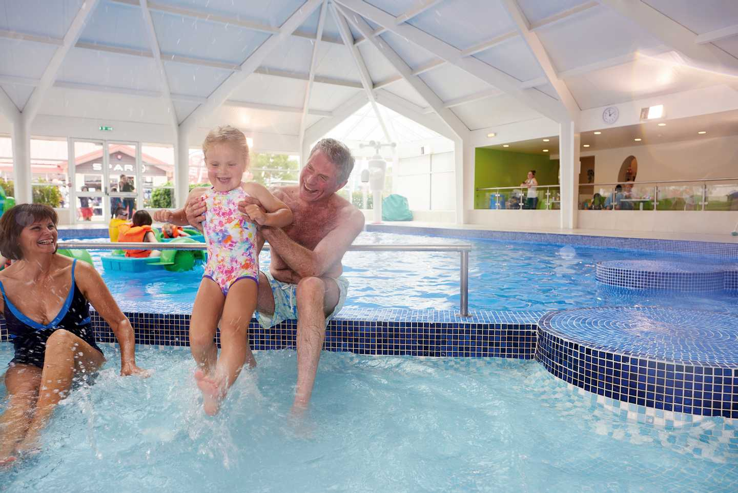 A family playing in the indoor pool