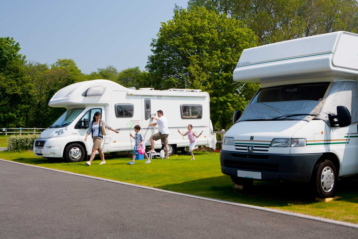 A pair of motorhomes hooked up to electrical points at Kiln Park