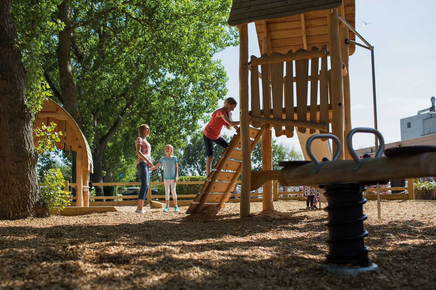 Children climbing in the outdoor play area