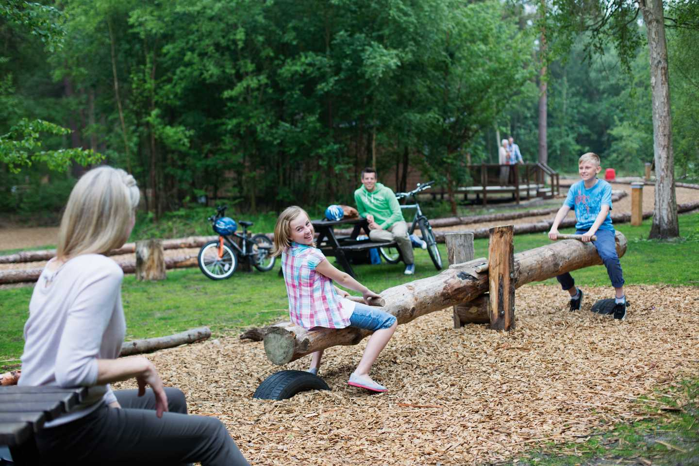 Kids sitting on the seesaw in the outdoor play area