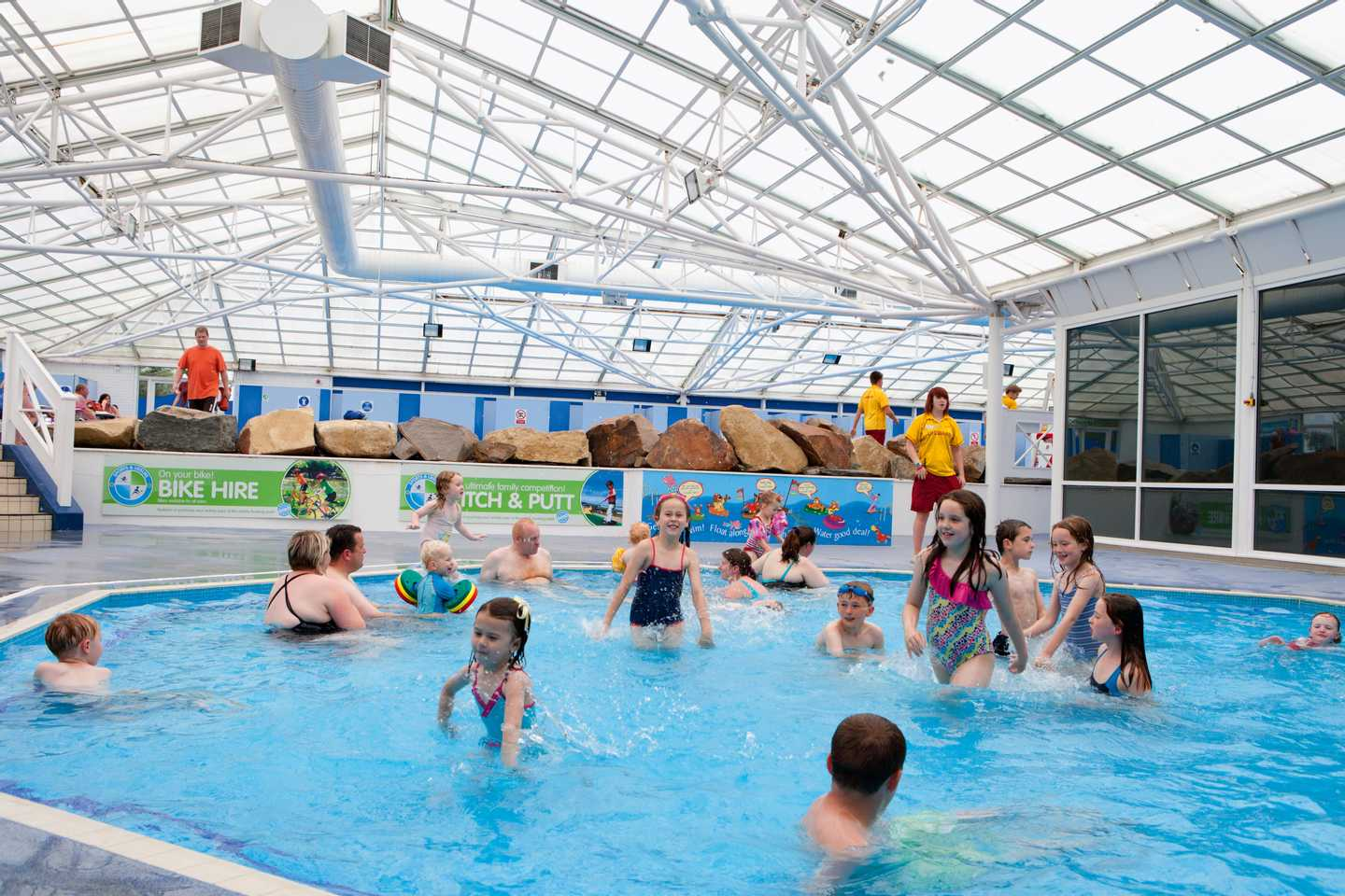 Guests in the indoor swimming pool at Greenacres