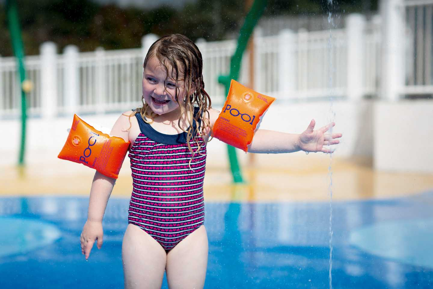 A young girl splashing around in the SplashZone
