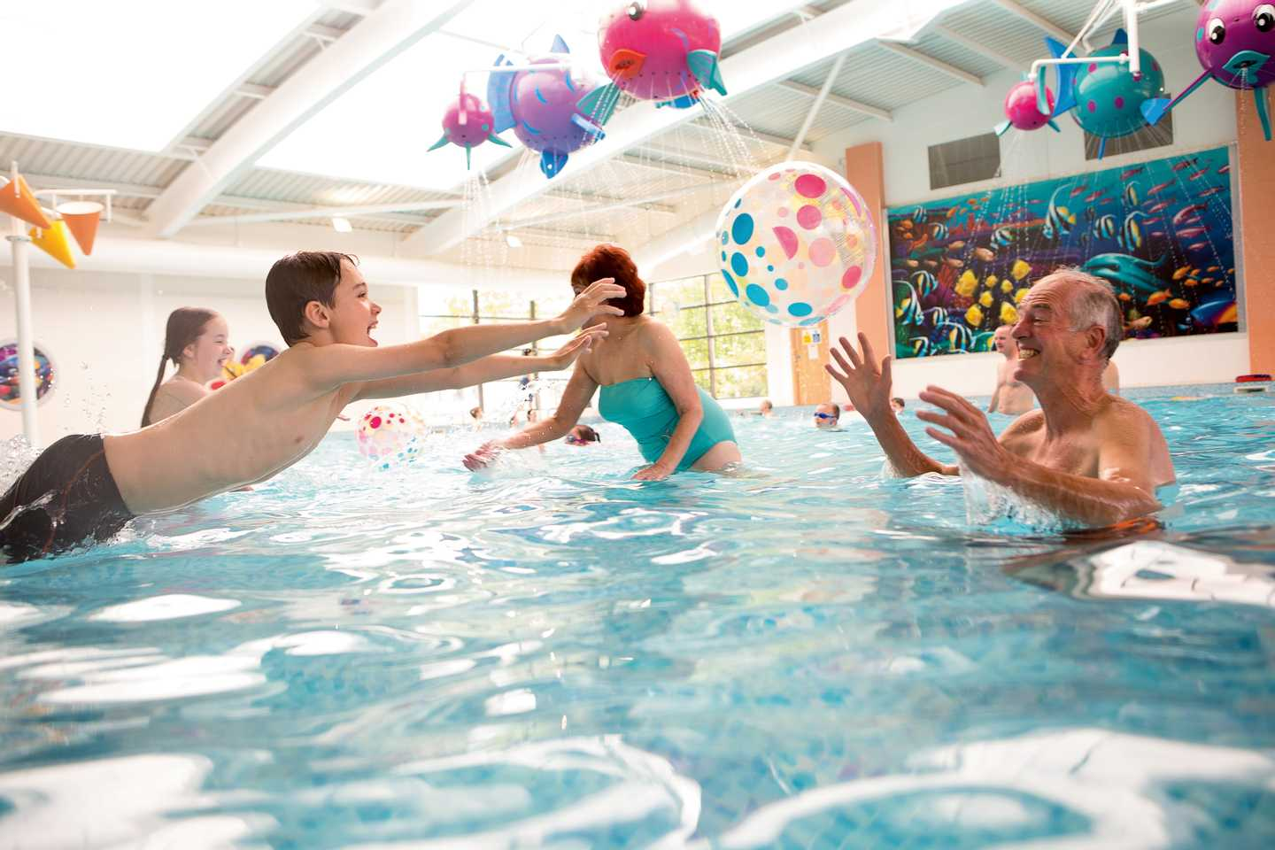 A family playing the in indoor pool