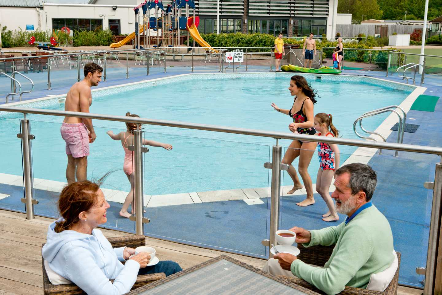 Guests getting ready for a dip in the outdoor pool at Lakeland