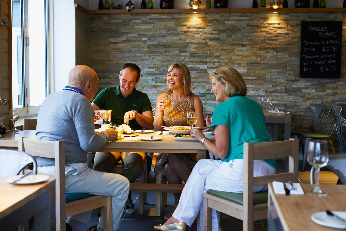 A family enjoying a meal in the Harbourside restaurant
