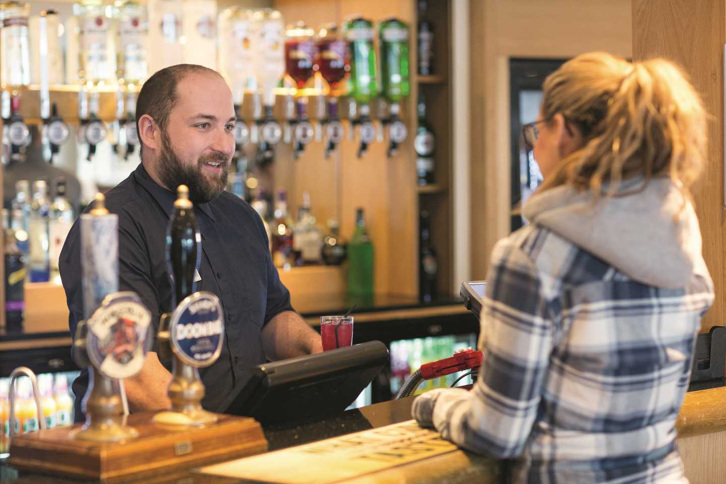 A guests ordering a drink at the bar