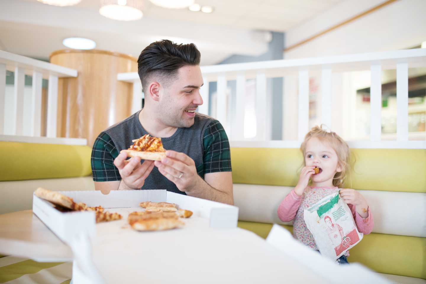 Guests enjoying pizza at Papa Johns