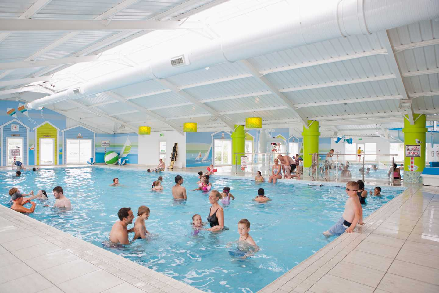 Lots of families playing in our heated indoor pool
