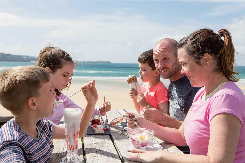 A family eating outside The Bluff Inn