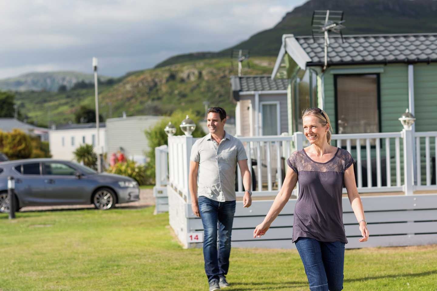 Owners walking beside the holiday homes at Cardigan View