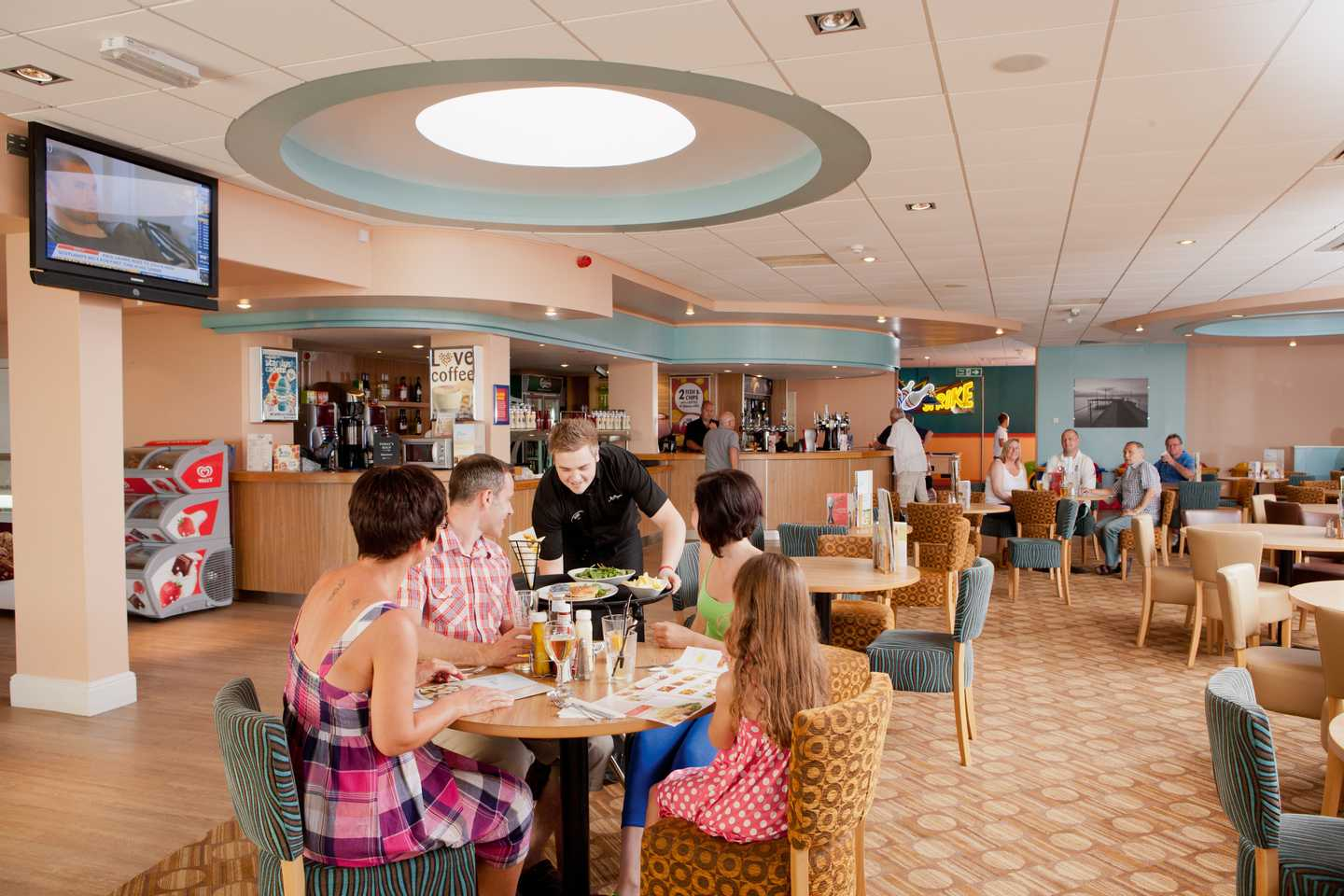 A family eating a meal in the Mash and Barrel restaurant