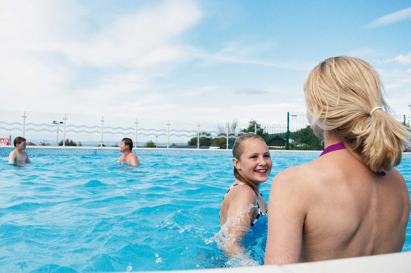 A family in the heated outdoor pool