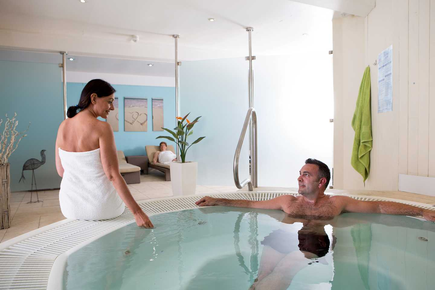 A couple relaxing in the owners' Jacuzzi at Quay West