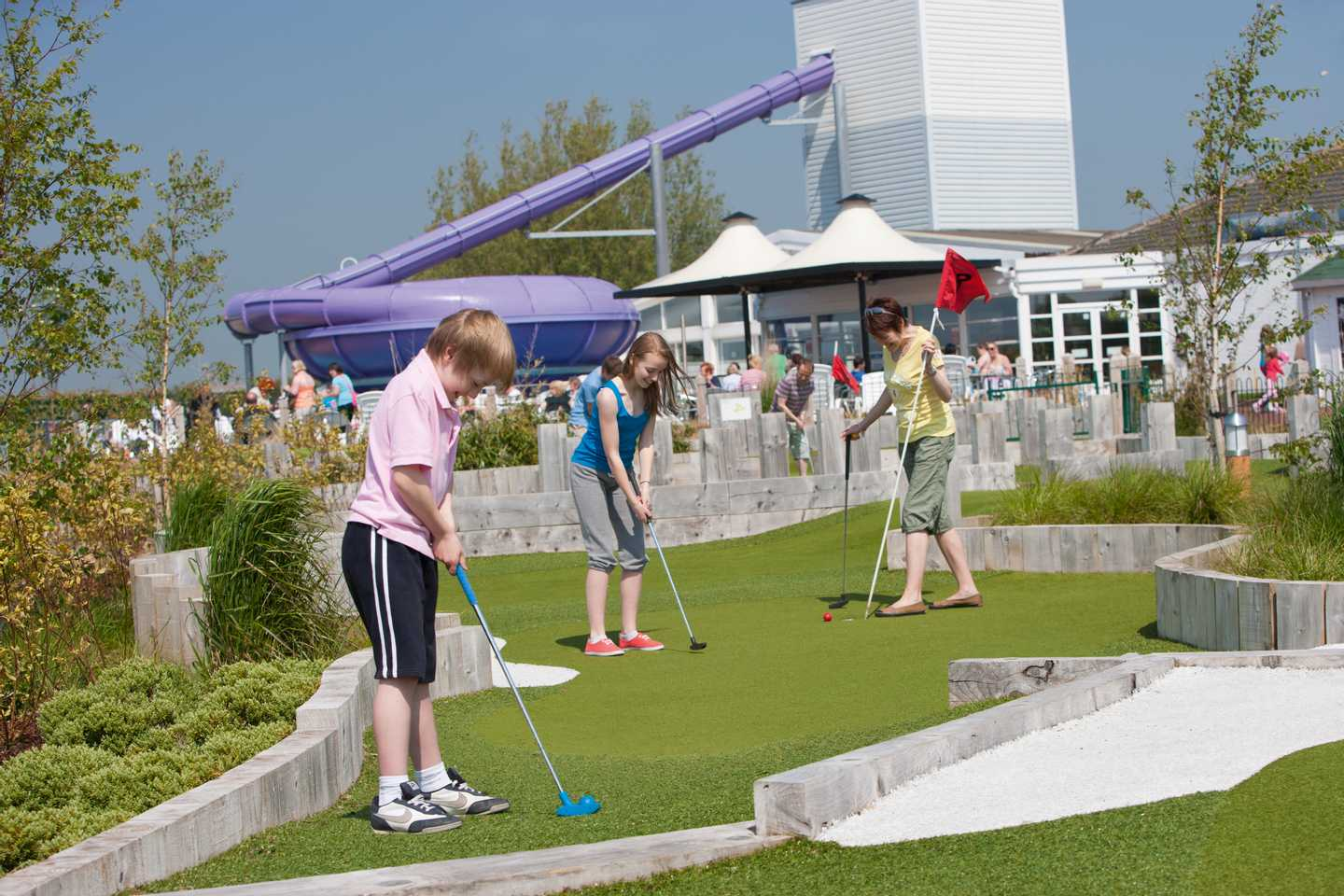 A family playing on the adventure golf course