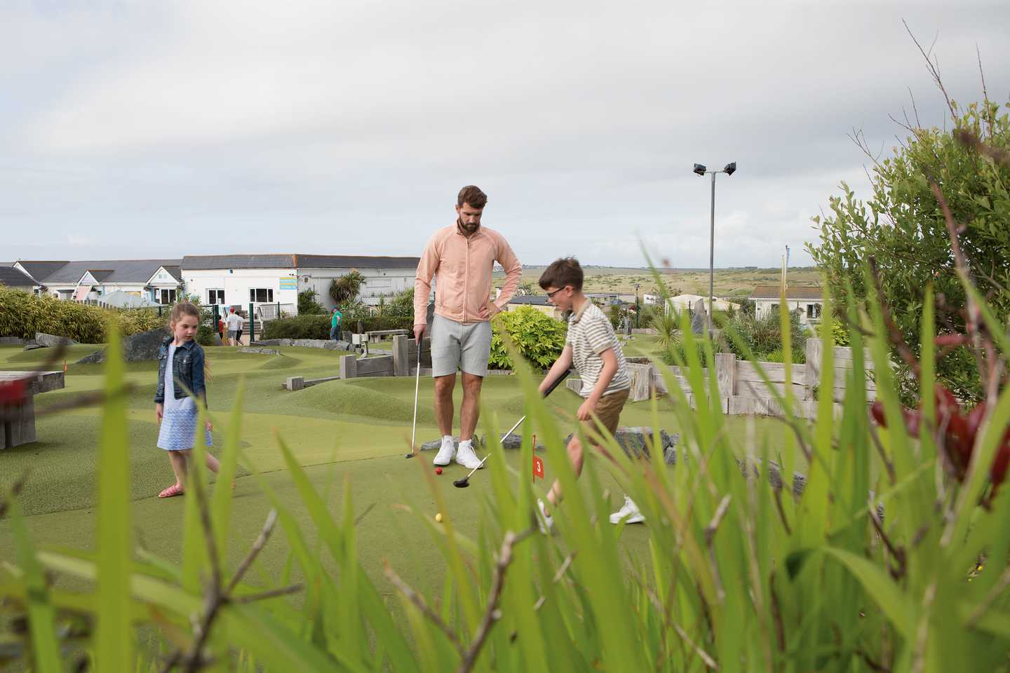 A father and son playing a round of Adventure Golf