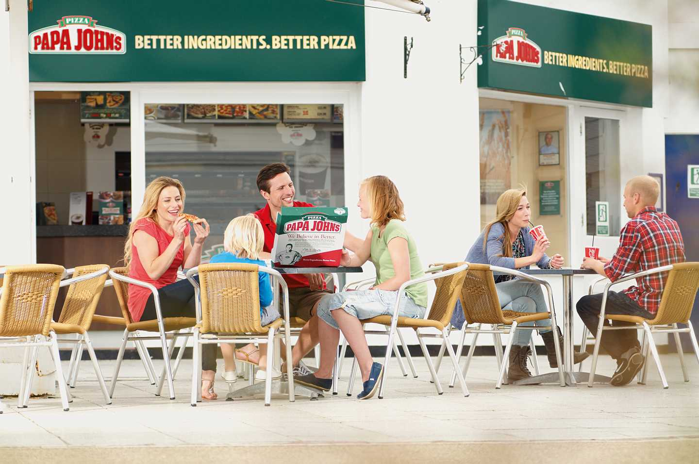 A group of guests sitting outside PAPA JOHN'S®