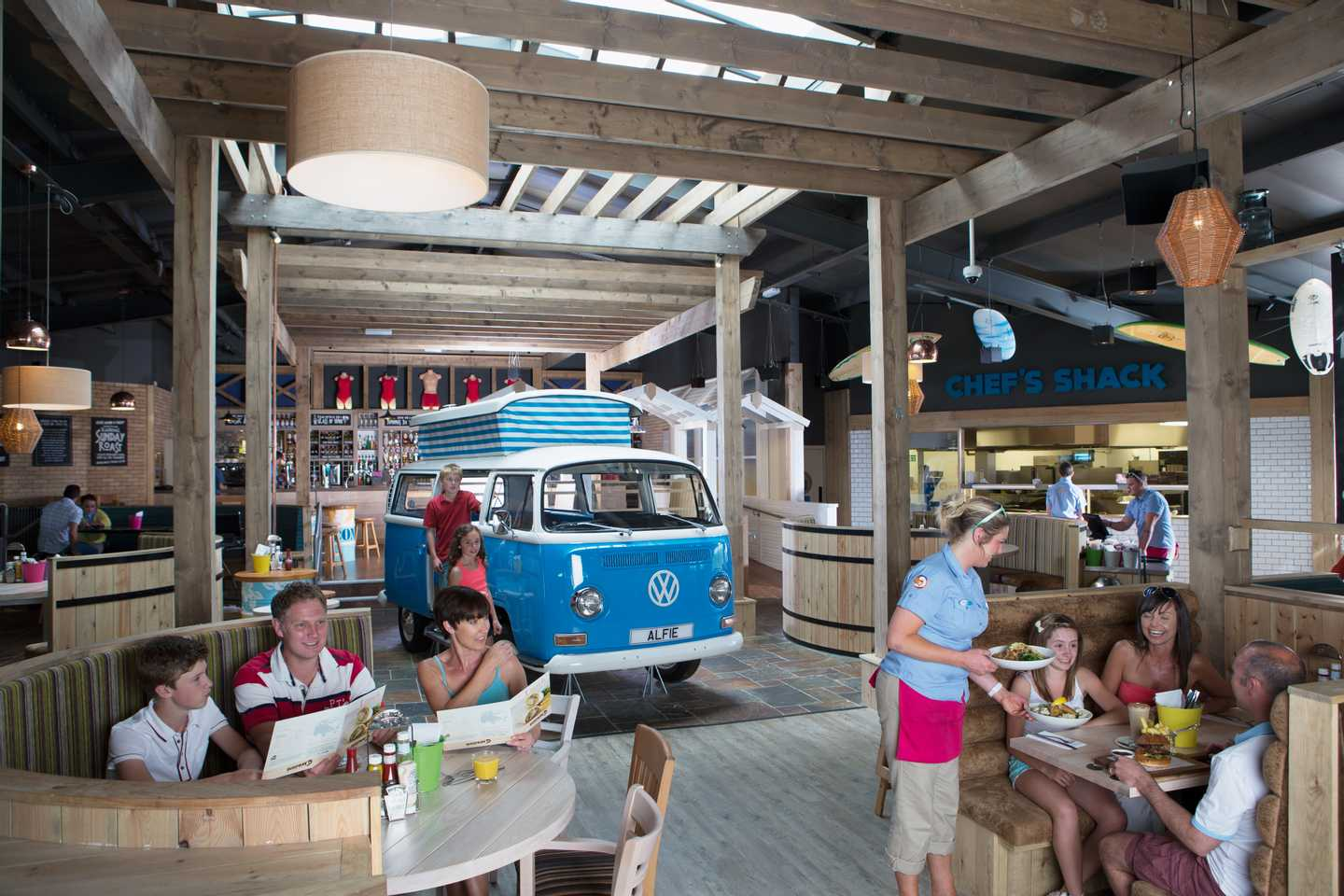 A picture of our Surf Bay restaurant with a nautical theme, wooden rafters and a VW camper in the middle of the floor