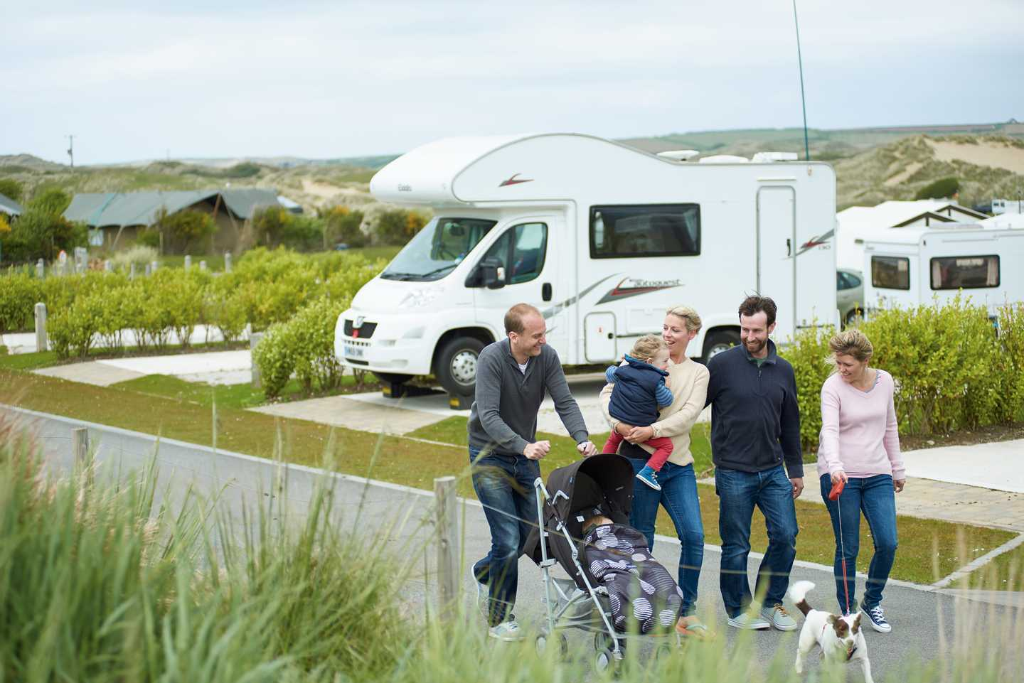 A family walking in the touring and camping area