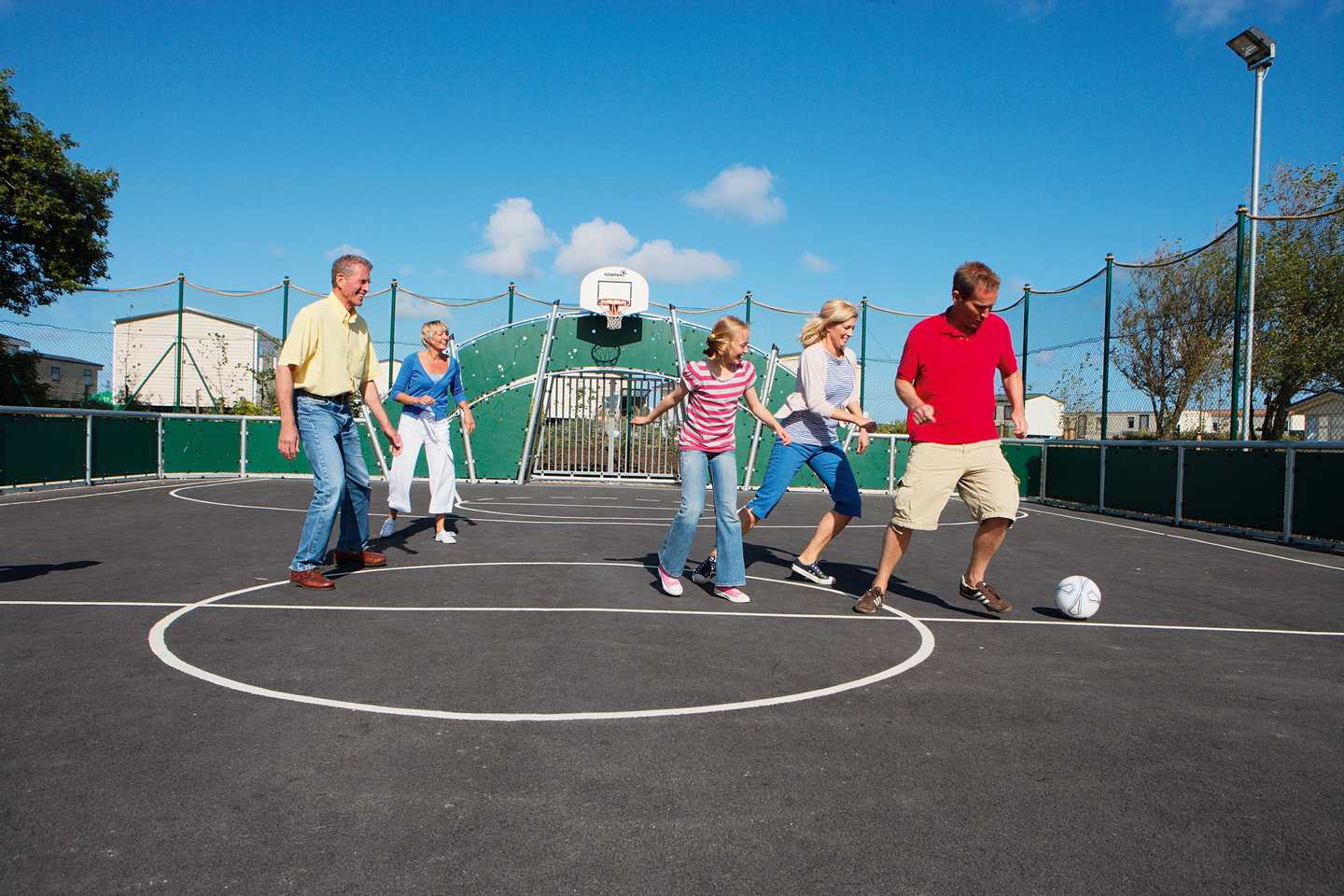 Guests playing football on the sports court