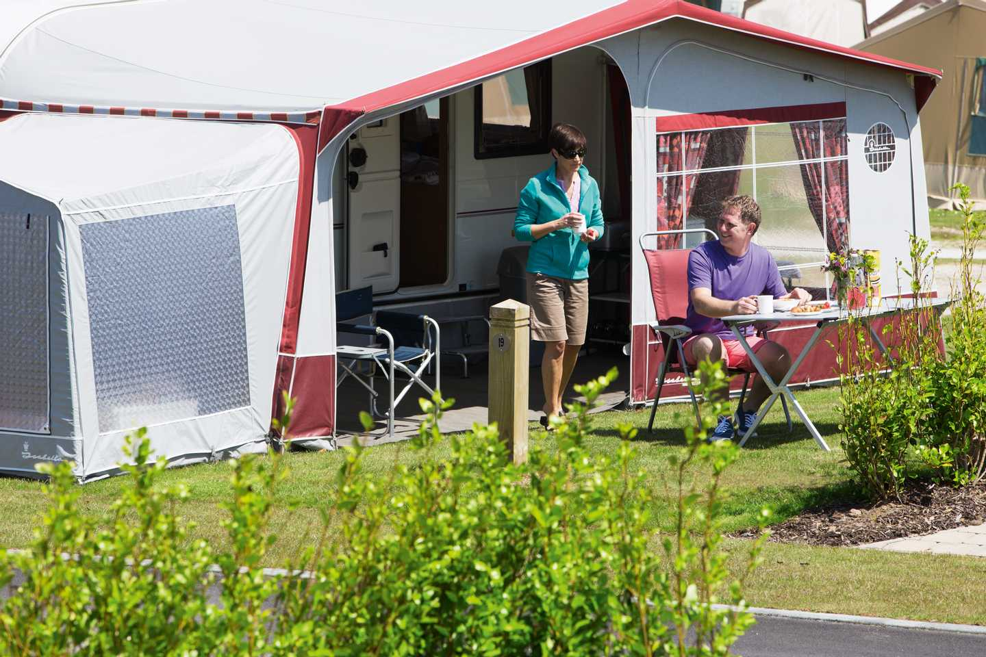 Guests outside their trailer tent