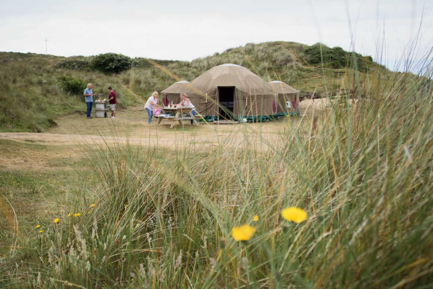 A family outside a Yurt (exclusive to Perran Sands)