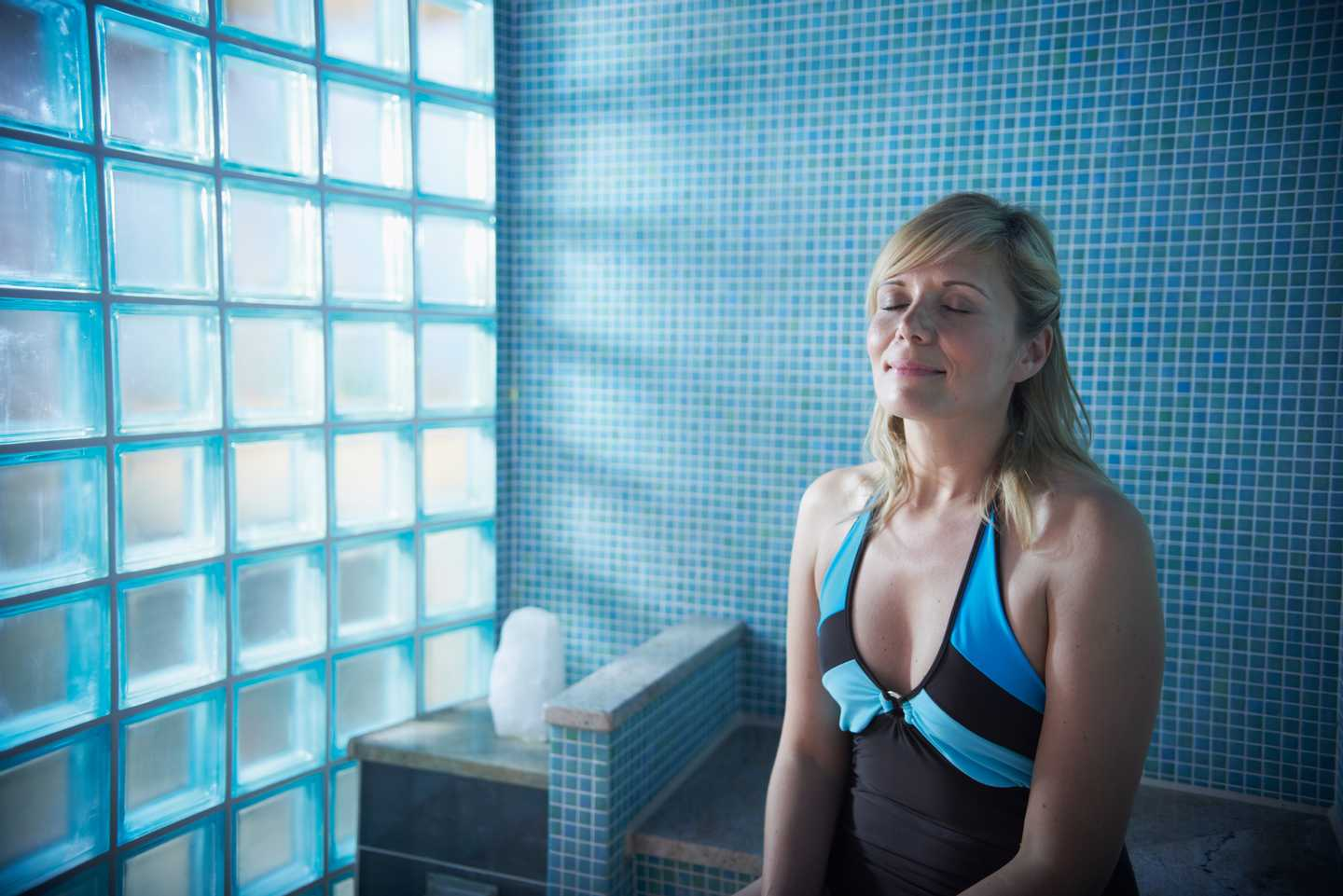 A lady relaxing in the sauna