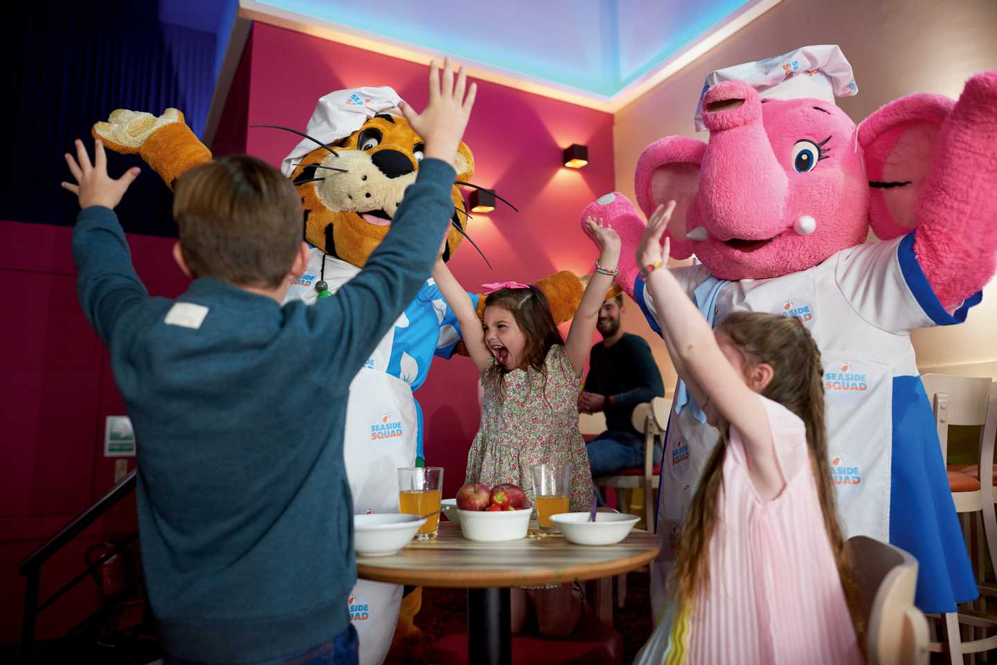 Children enjoying breakfast with the characters