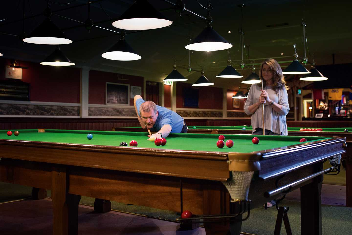 Owners playing a game of snooker