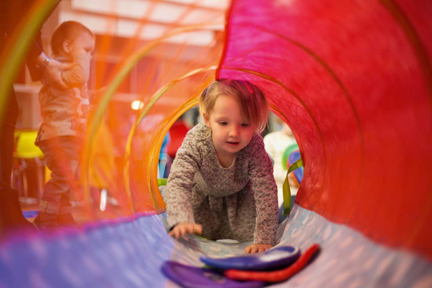 Child exploring sensory tunnel