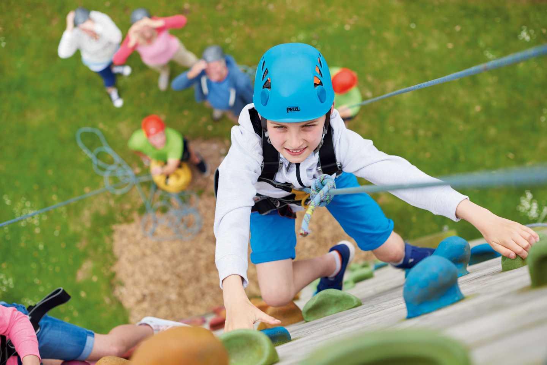 A guest climbing the climbing wall