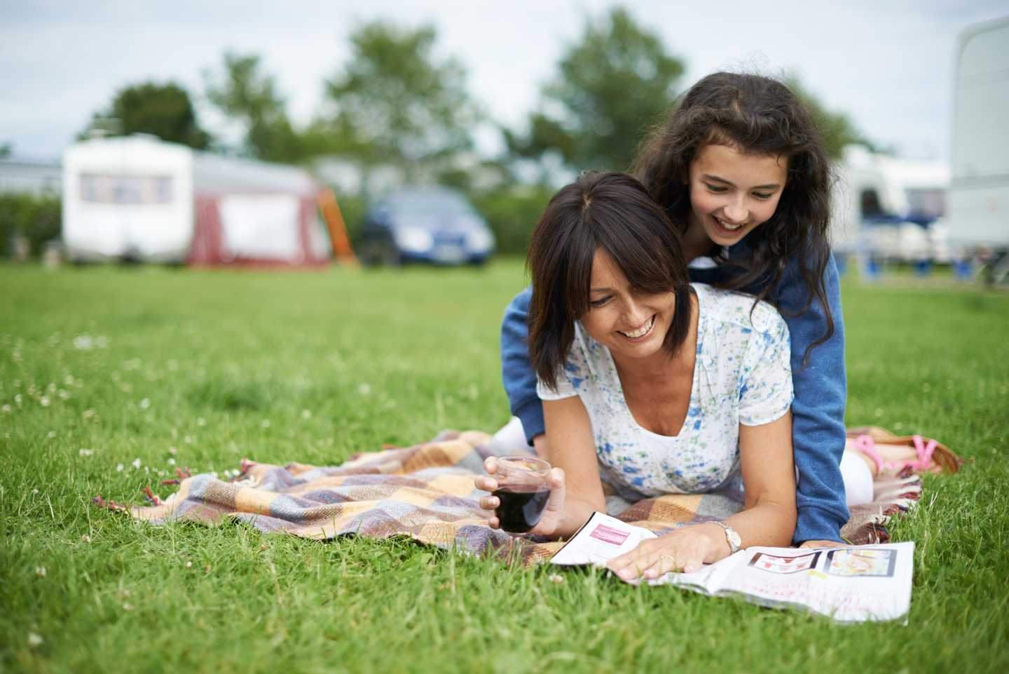 A mum and daughter playing on the grass at Golden Sands