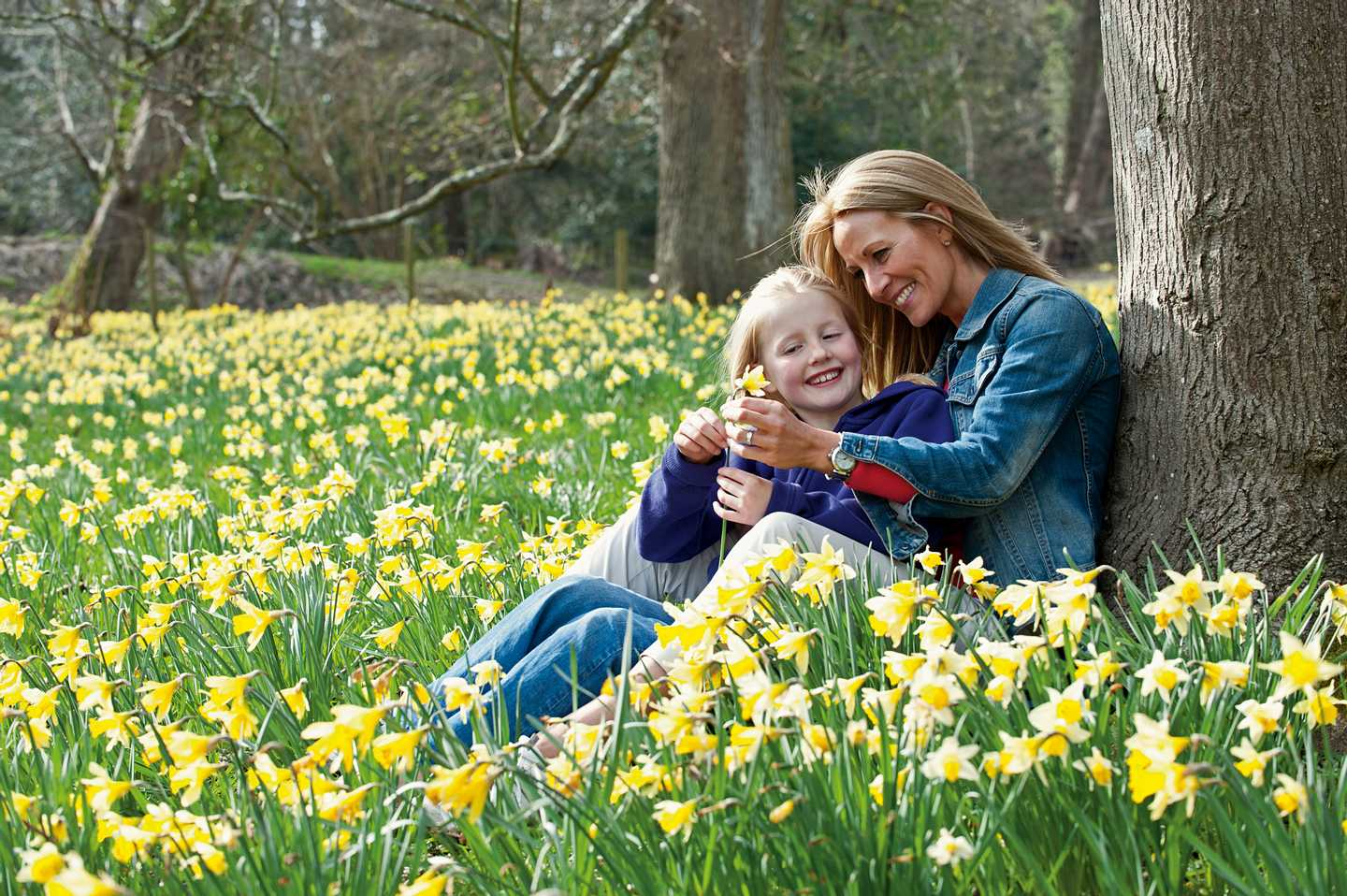 Mother and daughter relaxing in a field at spring time