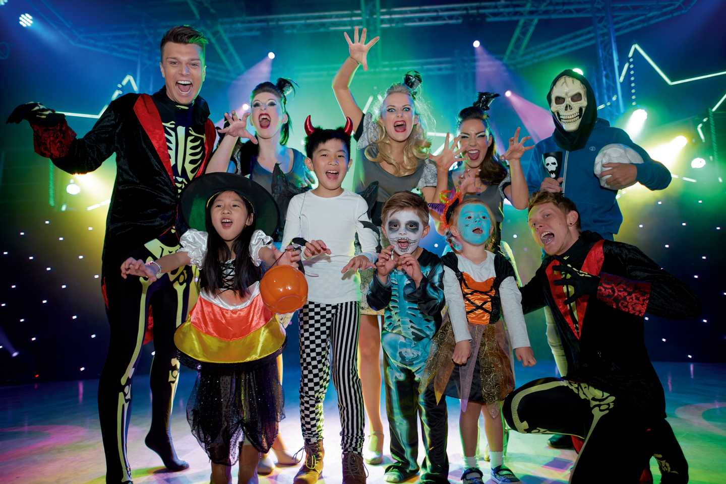 Some children and adults dressed up for Halloween on stage