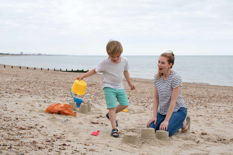 Parent and child building sandcastles