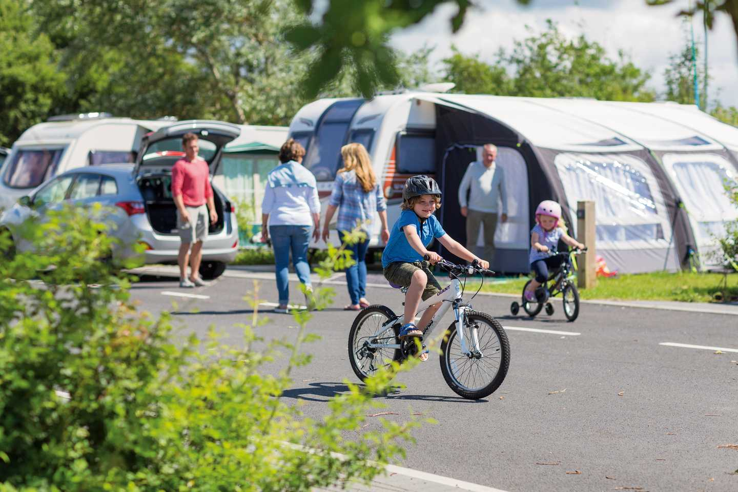 A child riding a bike in the touring area